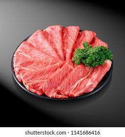 Premium Japanese wagyu beef sliced on plate for sukiyaki