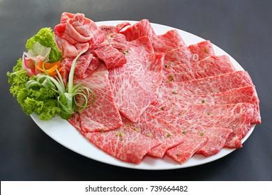 Premium Japanese wagyu beef sliced on plate for yakiniku with black background