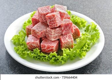 Premium Japanese wagyu diced beef cubes sliced on plate for yakiniku