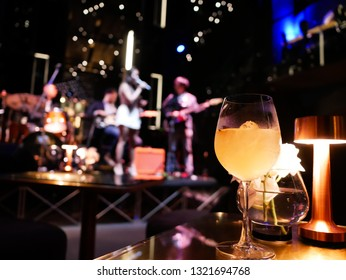 Premium mocktail in restaurant with blurred music band as background