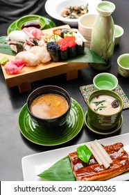 Premium quality grilled eel, miso soup, sake and sushi rolls served in Japanese restaurant. Asian food background