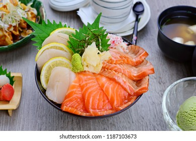 Premium Salmon Don.Sashimi Salmon Set with rice and topping.Served with salad, miso soup and green tea ice cream.Japanese Foods set in restaurant.Top view delicious dishes for designed work.Raw fishes