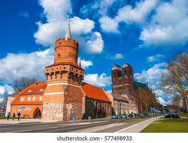 "PRENZLAU, GERMANY - APRIL 03, 2015: Gate Tower of the Brick Gothic '""Mitteltor"" and in background St. Mary's Church in Prenzlau in Brandenburg, Germany."