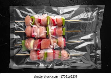 Prepack barbecue with vegetables and meat on skewers in a vacuum package. Ready to cook