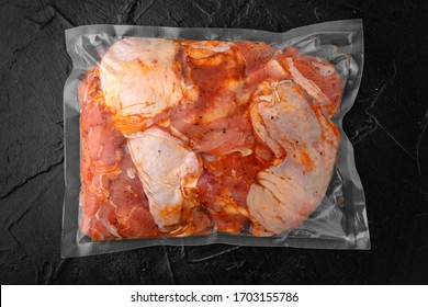 Prepack chicken marinated in sauce and spices package blowing (bagginess) in vacuum packaged ready to eat.