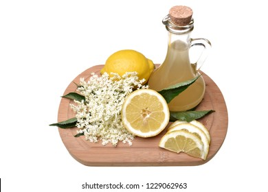 Preparated juice with lemon from elderflower isolated on white background