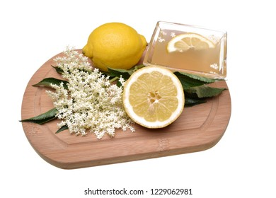 Preparated oil and juice with lemon from elderflower isolated on a white background
