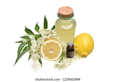 Preparated oil and juice with lemon from elderflower isolated on white background