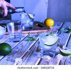 Preparation alcoholic mojito or alcohol-free cocktail at the bar. Gin, rum, light rum, tequila, vodka