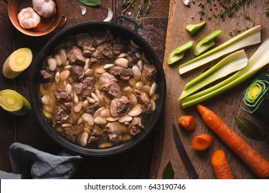 Preparation of cassoulet with pork and lamb and vegetables closeup