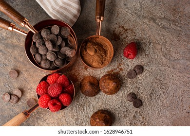 Preparation of chocolate truffles ingredients on the table close-up. view from above