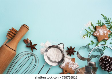 Preparation of Christmas gingerbread on a blue background. View from above