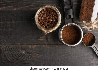 Preparation of coffee, ground coffee, coffee beans, on a dark background, top view with empty space for writing or advertising