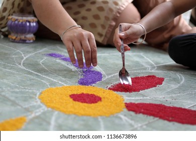 Preparation of colorful rangoli for Diwali celebration