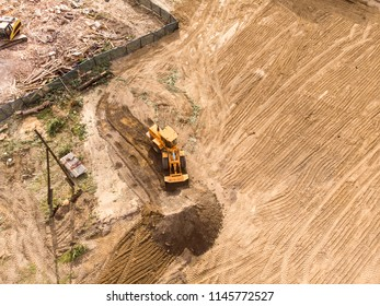 preparation of construction site for new buildings. yellow wheel loader doing earthmoving work. aerial view