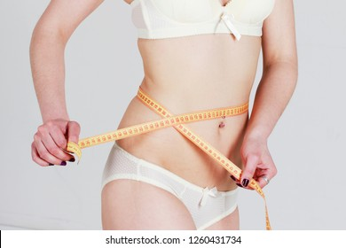 Preparation for cosmetic plastic surgery removal cellulite with body young woman.