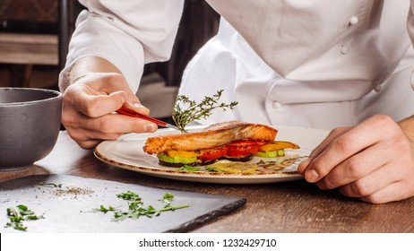 Preparation of dishes by a chef in a restaurant.