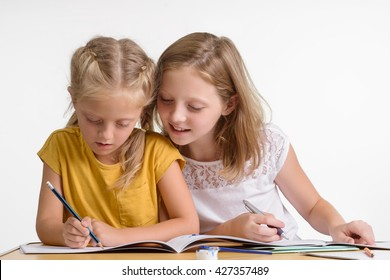 Preparation for examination is very important for children. Two lovely sisters help each other to do their homework. The elder sister is interested in evolution of the child.