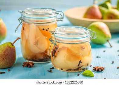 Preparation for fresh pickled sweet pears on blue table