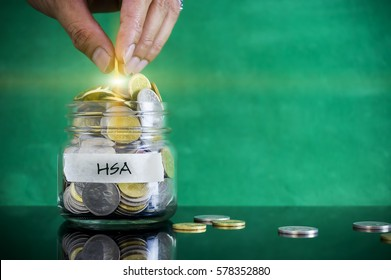 Preparation for future and financial concept. Coins in glass jar with HSA (Health Saving Account) label with light flare. Malaysia coins.
