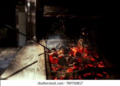 Preparation of grilling and coals for juicy steak