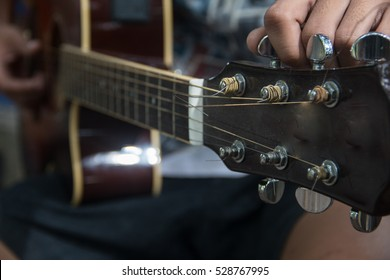 Preparation of guitarist,the man playing acoustic guitar