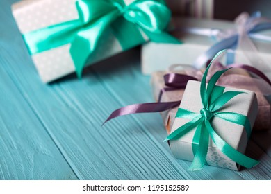 preparation for the holiday. Christmas. New Year gifts on a blue wooden background.