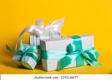 preparation for the holiday - a group of gifts on a yellow background