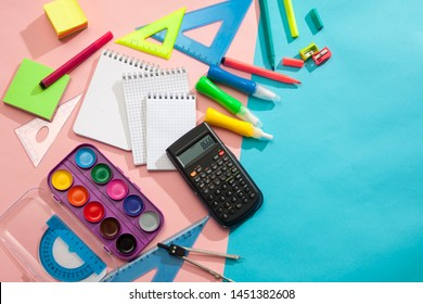 Preparation and learning of primary school children. Bright and multicolored school background with stationery accessories for the study of general subjects. Flat Lay, Copy space, place for text.