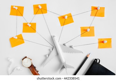 Preparation network for Traveling concept, push pin, pencil, watch, ear phone, string, paper noted on white background with copy space
