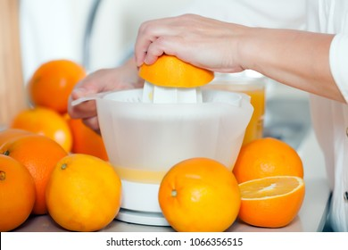 Preparation of orange juice on   mechanical manual juicer.