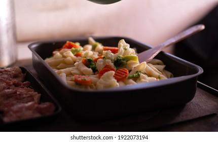 preparation of pasta with vegetables in the pan. healthy vegan food