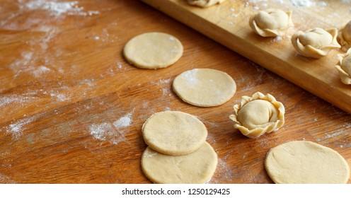 Preparation of pelmeni, ravioli, dumplings with minced meat close up