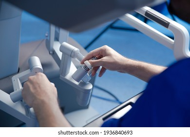 preparation for performing robotic surgery, doctor's hands