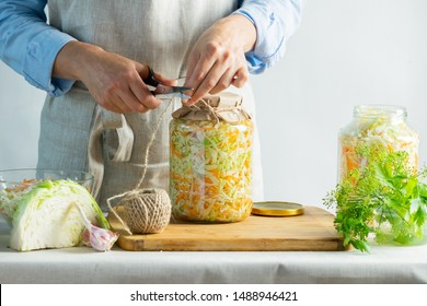 The preparation process fermentation preservation Sauerkraut on a light background. Natural rustic style. Canned food
