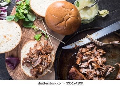 preparation of pulled pork sandwich