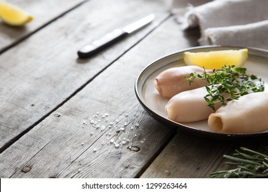Preparation of raw squid and ingredients on the table.