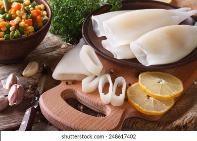 Preparation of raw squid and ingredients on the table close-up. horizontal