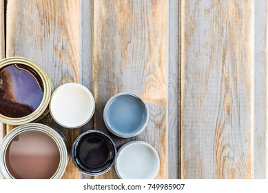 Preparation for the renovation of the Wooden Box with Open Cans of Different Paints, Varnish and Stain