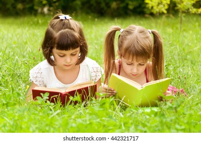 preparation for school in nature. two little girls playing in school. search top
