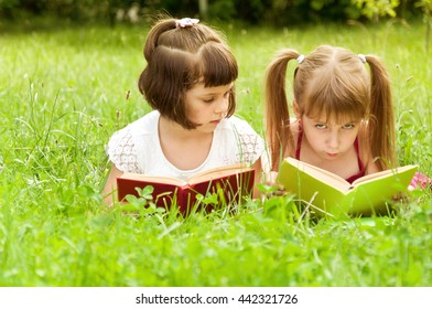 preparation for school in nature. two little girls playing in school