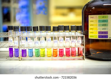 Preparation of standard pH solution, Matching the color of the bottle with the Universal Chemical Indicator  in chemistry laboratory. Close up image.