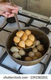 Preparation of traditional Arab sweets Luqaimat from dough with date syrup. Ramadan food.