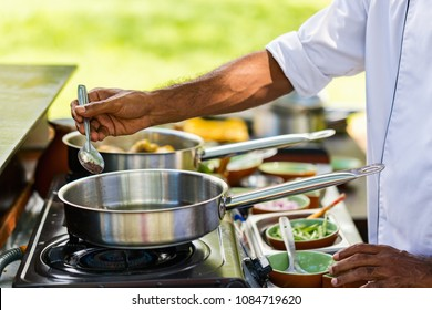 Preparation of traditional Sri Lankan curry dish with tender chicken breast at cooking class