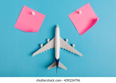 Preparation for Traveling concept, paper noted, airplane, push pin, on blue background with copy space.