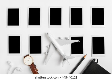 Preparation for Traveling concept, watch, airplane, pencils, book, earphone, Photo frame, on white background with copy space.