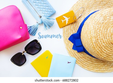 Preparation for vacation - hat, glasses, passport, cosmetic bag, purse. Summer inscription.