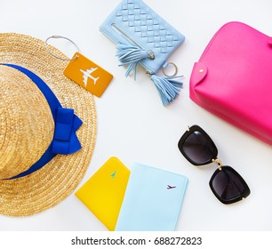 Preparation for vacation - hat, glasses, passport, cosmetic bag, purse. Close-up.