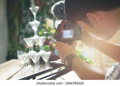 Preparation for wedding. Professional Videographer and photographer shooting celebration wine glasses in wedding ceremony.