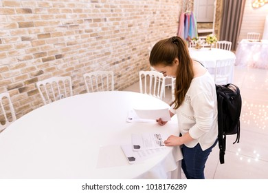 Preparation for the wedding, the search for a place for a wedding party. The bride reads the contract with the hall